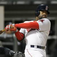 Clutch hit: Boston's Jackie Bradley Jr. hits a two-run double against Chicago in the 14th inning on Wednesday night. | AP