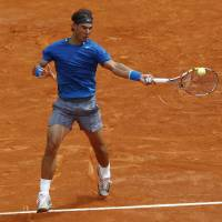 Favorite surface: Rafael Nadal plays a shot from Russia's Teymuraz Gabashvili in their second-round match on clay at the Monte Carlo Masters on Wednesday. Nadal won 6-4, 6-1. | AP