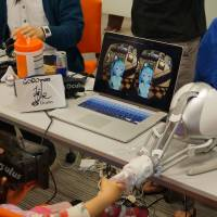 MikuMikuAkushu uses a robotic hand for further immersion.   ADAM MILLER
