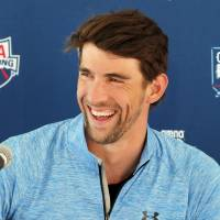 Fit and ready: Michael Phelps speaks to the media following practice in Mesa, Arizona, on Wednesday. Phelps will make his return to the pool at the Arena Grand Prix on Thursday after a two-year retirement. | AP