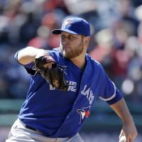 Still unbeaten: Toronto's Mark Buehrle throws a pitch against Cleveland on Saturday. The Blue Jays blanked the Indians 5-0. | AP
