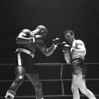 Storm brewing: Rubin 'Hurricane' Carter fights Italy's Fabio Bettini in Paris in 1965. Carter earned a 10th-round knockout. | AP
