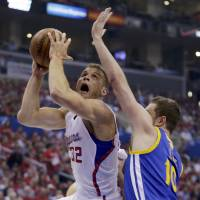 Scores 35 in win: Los Angeles' Blake Griffin goes up for a shot against Golden State's David Lee in the first half of Game 2 on Monday night. The Clippers routed the Warriors 138-98. | AP
