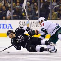 Leveled: Los Angeles' Drew Doughty is knocked to the ice by Minnesota's Matt Cooke in the second period on Monday night. | AP