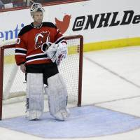 End of the road: Devils goalie Martin Brodeur stands in front of the net during the third period. | AP