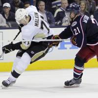 Slash and grab: Columbus' James Wisniewski tries to stop Pittsburgh's Evgeni Malkin in Game 3 on Monday night. | AP