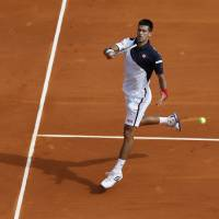 Easy does it: Novak Djokovic plays a shot during his win over Albert Montanes at the Monte Carlo Masters on Tuesday. | AFP-JIJI