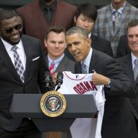 Seal of approval: U.S. President Barack Obama accepts a Red Sox jersey from Boston designated hitter David Ortiz during a ceremony honoring the 2013 World Series champions on Tuesday. | AP