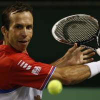 Long duel: The Czech Republic's Radek Stepanek hits a return to Japan's Tatsuma Ito during their 3-hour, 53-minute Davis Cup singles match on Friday at Ariake Colosseum. | REUTERS