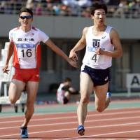 Walk before you can run: Yoshihide Kiryu (right) competes at a meet in Izumo, Shimane Prefecture, on Sunday. | KYODO