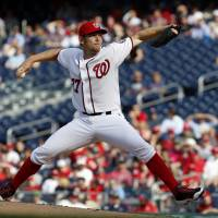 Impressive in win: Washington's Stephen Strasburg throws a pitch against Miami in the fourth inning on Thursday. The Nationals beat the Marlins 7-1. | AP