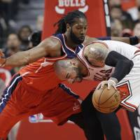 No entry: Washington's Nene (left) guards Chicago's Carlos Boozer during the Wizards' 102-93 playoff win on Sunday.   AP