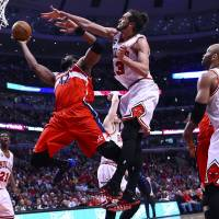 Magic trick: Washington's Nene goes to the basket as Chicago's Joakim Noah defends during the Wizards' 101-99 overtime win on Tuesday. | REUTERS/USA TODAY