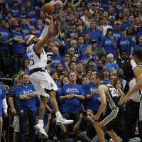 Beat the clock: Dallas' Vince Carter puts up the game-winning 3-pointer against San Antonio on Saturday. The Mavericks edged the Spurs 109-108 and now lead the series 2-1. | AP