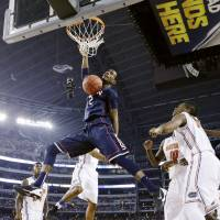 With authority: Connecticut forward DeAndre Daniels dunks against Florida during their Final Four contest on Saturday in Arlington, Texas. UConn won 63-53. | AP