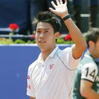 Moving on: Kei Nishikori waves to the crowd after his victory over Kazakhstan's Andrey Golubev in the third round on Thursday at the Barcelona Open. Nishikori won 6-0, 6-4. | KYODO