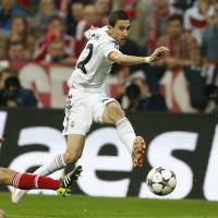 Real deal: Real Madrid's Angel di Maria shoots past Bayern Munich's Philipp Lahm during Real's 4-0 Champions League semifinal second-leg win at the Allianz Arena in Munich on Tuesday. | AP