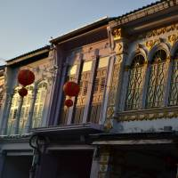 Faded glory: The sun sets on Peranakan buildings on Thalang Road in Phuket. These 19th-century buildings were built in a 'Sino-Portuguese' style. | NICK WALKER