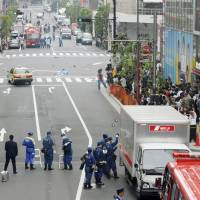 Dastardly deeds: Police survey the scene of Tomohiro Kato's Akihabara massacre in 2008. | KYODO