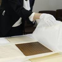 The original 1890 Imperial Rescript on Education is unveiled at the education ministry Monday. | KYODO