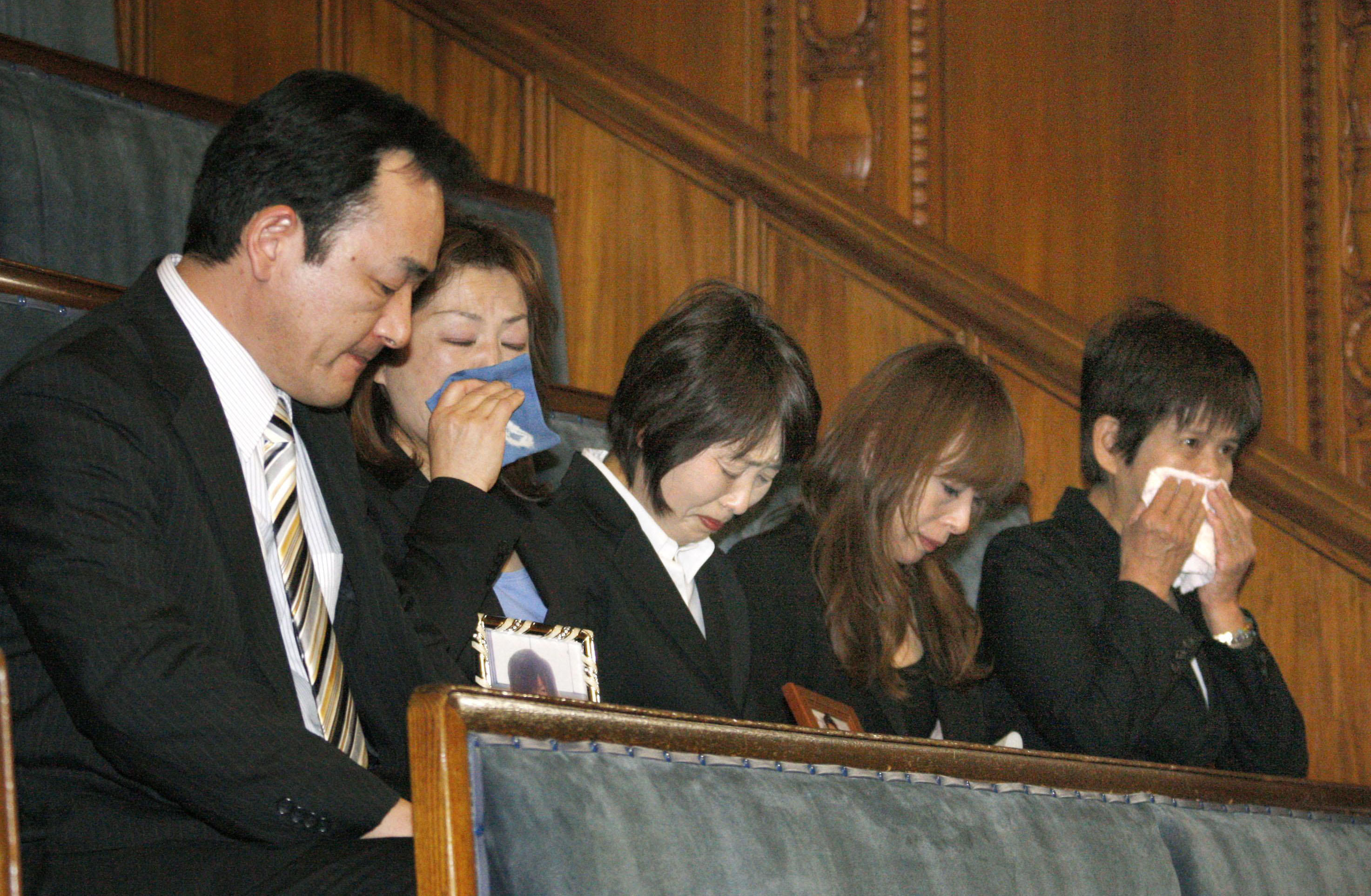 Relatives of a person victimized by a crime committed by a minor watch as the Upper House enacts the stiffened juvenile law on Friday. | KYODO