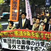 Demonstrators on Tuesday march from Tokyo's Hibiya Park to the Diet building to protest the government's attempt at reinterpreting the Constitution to enable Japan to exercise the right to collective self-defense. | SANG WOO KIM