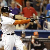 That's all folks: Marlins slugger Giancarlo Stanton hits a game-winning grand slam against the Mariners in the ninth inning on Friday. | AP