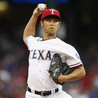 You can't ask for more: Rangers pitcher Yu Darvish pitches against the Astros on Friday in Arlington, Texas. Darvish allowed one hit and struck out nine over eight innings. | AP