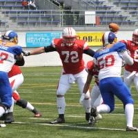 Japan rolls to 2015 IFAF berth with rout