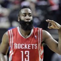 Give me all three: Rockets guard James Harden flashes three fingers after nailing a 3-pointer against the Trail Blazers on Friday in Portland. | AP