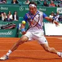 Giant killer: David Ferrer hits a return to Rafael Nadal during their match at the Monte Carlo Masters on Friday. Ferrer advanced to the semifinals of the clay-court event courtesy of a 7-6 (7-1), 6-4 upset of No. 1 Nadal. | REUTERS
