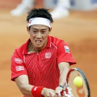Right back at you: Kei Nishikori returns a shot against Marin Cilic during their match on Friday. | KYODO