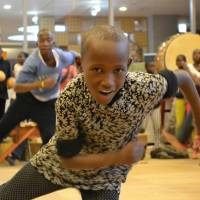 Kimbugwe Pius, 10, from Uganda, practices dance moves during a rehearsal for his role in 'At Home in the World' performance on March 19 in Hino, Tokyo. | KYODO