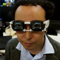 This combo picture released by University of Tsukuba assistant professor Hirotaka Osawa on Saturday shows the AgencyGlass. Developed by Osawa, its OLED screens display emotional expressions with the wearer's digital eyeball images. | AFP PHOTO/UNIVERSITY OF TSUKUBA/HIROTAKA OSAWA