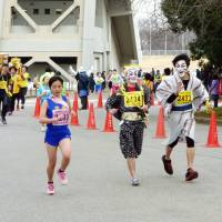 Participants in an 'ekiden' hosted by Chiba Urban Monorail Co. in March don costumes as part of the relay race. | KYODO