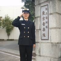 Miyake poses at the gate of the MSDF Band's Tokyo headquarters on Nov. 23, 2011. | AFP-JIJI/MARITIME SELF-DEFENSE FORCE