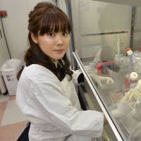Scientist Haruko Obokata poses at her lab at Riken's Center for Developmental Biology in Kobe at the end of January. | KYODO