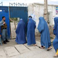 Poll success puts Afghans on track — for now