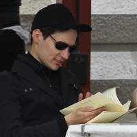 Pavel Durov, founder of Russia's leading social network, VKontakte, sits in a cafe in Moscow's Red Square in May 2012. | AP