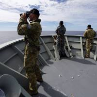 In MH370 search, Malaysia, Australia put aside robust history of rancor and barbed comments