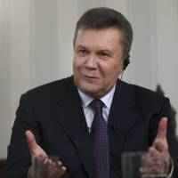 Former Ukrainian President Viktor Yanukovych gives an interview Wednesday in the Russian city of Rostov-on-Don, the first public appearance he has made since his ouster. | AP