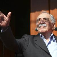 Colombian Nobel Prize laureate Gabriel Garcia Marquez greets journalists and neighbors on his birthday outside his house in Mexico City on March 6. | REUTERS