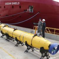 An AUV to be used in the search for missing Malaysia Airlines Flight MH370 sits on the wharf at the Australian naval base HMAS Stirling in Perth on Sunday. | AP