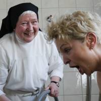 A guest to Marienkron, an abbey retreat in Gols, Austria, is given Kneipp hydrotherapy on Friday by Sister Elisabeth, a Cistercian nun at the retreat.   REUTERS