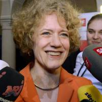 Zurich Mayor Corine Mauch, who was born a U.S. citizen, speaks to reporters after her re-election on Feb. 9. | AP