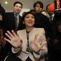Thai Prime Minister Yingluck Shinawatra leaves the National Anti-Corruption Commission office in Nonthaburi province, on the outskirts of Bangkok, on Monday. | REUTERS