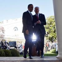 President Barack Obama walks with Vice President Joe Biden after speaking about the Affordable Care Act at the White House on Tuesday. | AFP-JIJI
