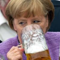 German Chancellor Angela Merkel drinks beer at the 'political morning pint' event at the Gillamoos fair in Abensberg, southern Germany, in September 2012. The Gillamoos fair is one of the biggest political spectacles in lower Bavaria.   AFP-JIJI