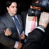 Mark Karpeles, chief executive officer of bankrupt bitcoin exchange Mt. Gox, is seen leaving the Tokyo District Court at the end of February. | BLOOMBERG