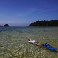 An American tourist snorkels in February near Lampi Marine National Park on Lampi Island, Myanmar. Inaugurated in 1996, the park had no rangers until last year. | AP